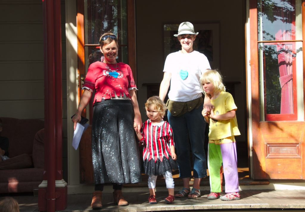 Board members & kids standing on FairField House verandah